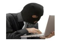 A masked criminal trying to hack data but cannot get in because it is encrypted