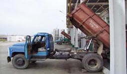 A dump truck unloading to represent FACT unloading big data