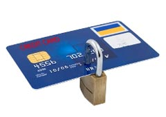 A padlock through a credit card showing that the credit card information is secure