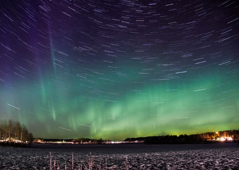 Stars and aurora borealis blending in the sky