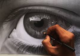 a hand drawing an eye