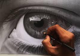 a hand drawing an eye